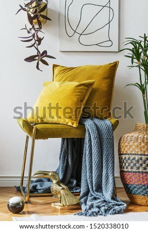 Stylish and luxury living room of apartment with gold bench, velur pillows, etno vase with flowers, sculpture and elegant personal accessoreis. Modern home decor. Interior design. Template.