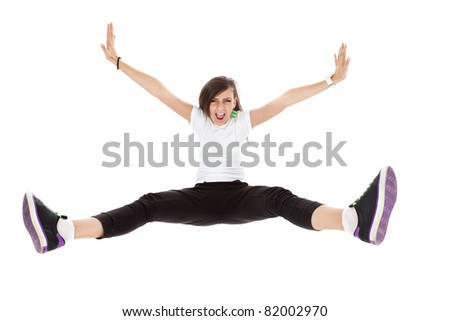 stylish and young modern style dancer is posing in an energy jump
