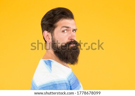 Stylish beard and mustache care. Hipster appearance. Beard fashion and barber concept. Man bearded hipster stylish beard and mustache yellow background. Barber tips maintain beard.