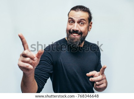 Stylish bearded hipster man with appealing dark eyes smiling into camera. Hipster man with beard  having cheerful look. Positive emotions.Crazy emotions. joy. The idea came. The emotional portrait.  #768346648