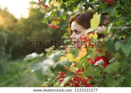 stylish beautiful stylish young model woman with red berries