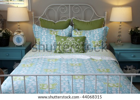 Stylish bedroom furniture and contemporary decor.
