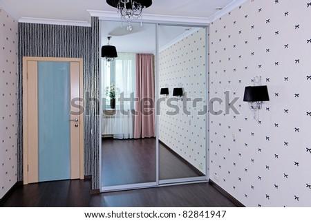 Stylish bedroom interior, door view