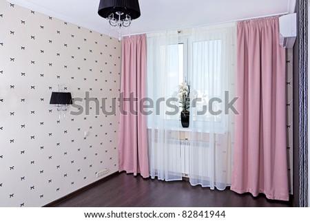 Stylish bedroom interior, window view