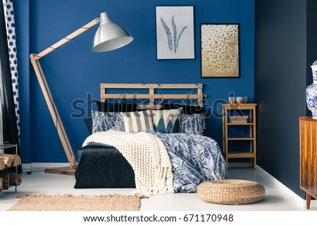 Stylish bedroom interior with dark blue wall #671170948