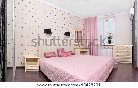 Stylish bedroom interior with double bed