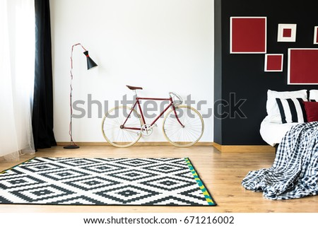 Stylish bicycle in spacious and minimal bedroom - Shutterstock ID 671216002