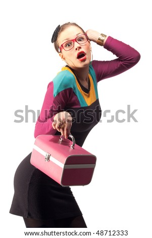 Stylish bizarre woman posing in retro dress with pink purse in her hands. Isolated over white background.
