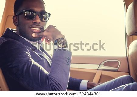 Stylish black man in the car.