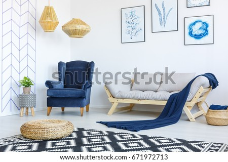 Stylish blue and white living room interior with armchair and sofa #671972713