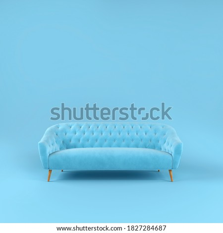 Stylish blue fabric sofa with wooden legs on blue background with shadow. Fashionable comfortable single piece of furniture. Blue interior, showroom. Vilyura, velvet sofa. Luxury couch front view