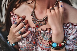 Stylish boho chic woman. Fashionable indian hippie gypsy bohemian outfit with jewelry accessories details