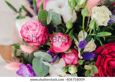 Stylish bouquet of fresh flowers. Composition from freesia, roses, eucalyptus leaves. Close up #606758009