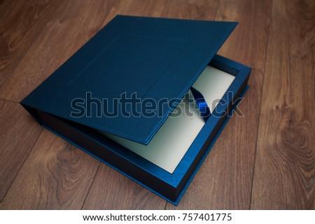 stylish  box for photobooks.. cardboard box for a photo album.  Box for wedding album. leather photo book in the box cardboard box for a photo book