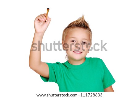 Stylish boy in green top drawing with brush on white background