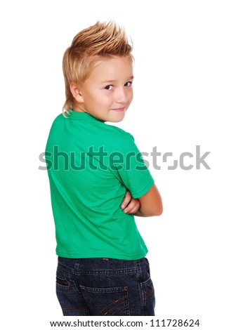 Stylish boy in green top looking back  on white background
