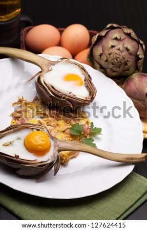 Stylish Breakfast - Creative Easter meal with eggs baked in artichokes halves.
