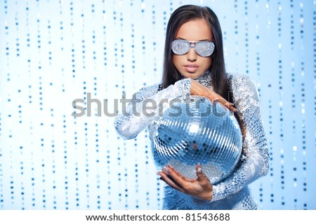 Stylish brunette with a disco ball