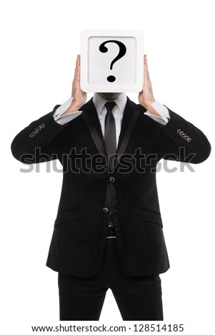 Stylish business man holding a white square box over his face with a question mark on it. Isolated on white background.