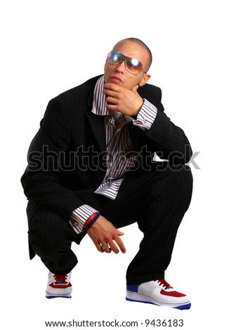 Stylish Business Young man in stylish business fashion with sunglasses on - over white background.