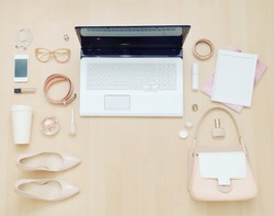 stylish casual set of computer and stuff for urban woman in soft colors, fashion concept