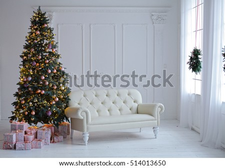 Stylish Christmas scandinavian minimalistic interior with an elegant sofa. Comfort home. Presents and wrapped gifts under the Christmas tree with light and bauble in sunny living room