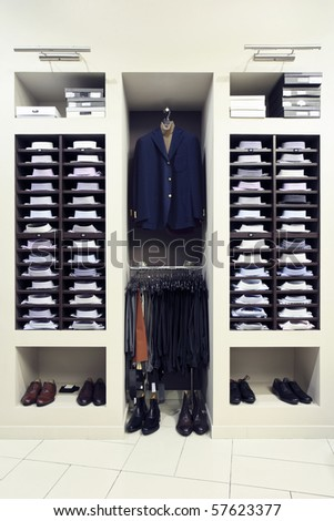 Stylish clothes in a modern shop interior - stock photo