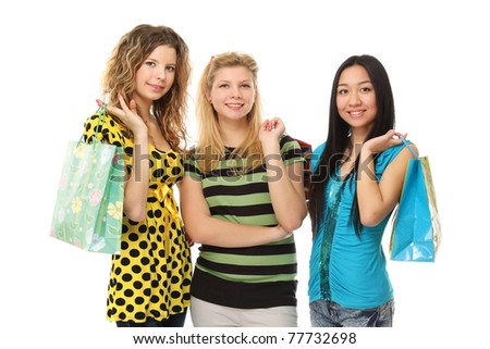 Stylish college girls with shopping bags