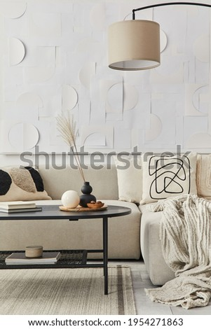 Stylish composition at fancy interior with wooden coffee table, dried flowers in vase, pillow, blanket, art painitngs and book in modern home decor. Details. Template. Foto stock ©