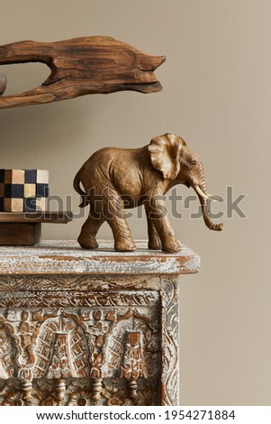Stylish composition at moroccan interior with wooden shlef, cube, design elephant figure and decoration in modern home decor. Details. Template. Foto stock ©