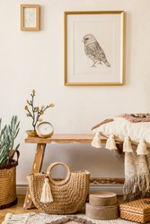 Stylish composition of living room interior with mock up frame, wooden bench, pillow, plaid, woman bag, books, cacti, macrame, plant, decortaion and elegant personal accessories in modern home decor.