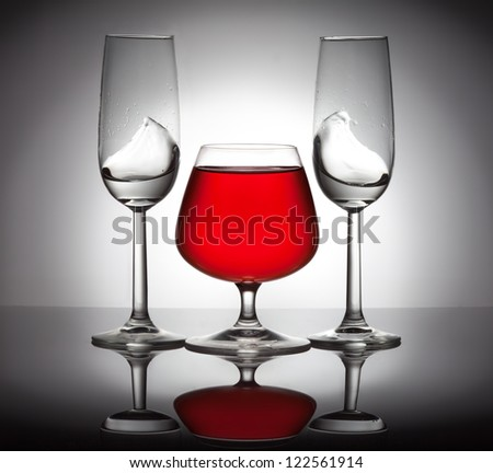 Stylish composition of three glasses of champagne and cognac