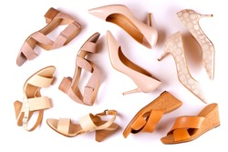 Stylish composition with variety of multiple classic women's leather sandals shoes w/ medium heels, different styles, white background. Copy space, top view, flat lay. Shoe sale / clearance ad concept