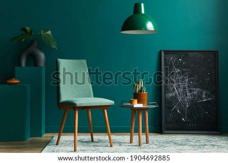 Stylish concept of living room interior with design chair, tropical leaf in vase, black mock up poster map, retro carpet, decoration, cacti, pendatn light and accessories in modern vintage home decor. Stock photo ©