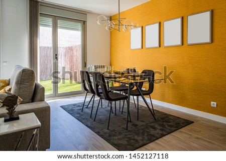 Stylish contemporary living room interior in white and yellow colors with sofa, table and posters on wall. Scandinavian interior design #1452127118