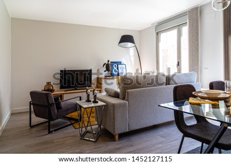 Stylish contemporary living room interior in white color with sofa and table. Scandinavian interior design #1452127115