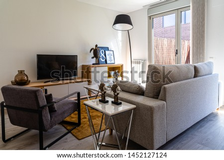 Stylish contemporary living room interior in white color with sofa and table. Scandinavian interior design #1452127124