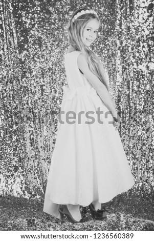 stylish cute kid posing on silver background. #1236560389