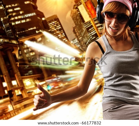 Stylish dancing girl against night city