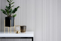Stylish decoration in gold and black on white, high gloss console table