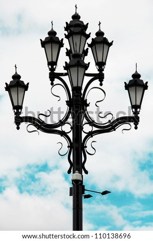 Stylish decorative street lamp with the religious touch in Moscow, Russia
