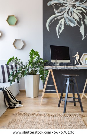 Stylish designed office connected with cozy bedroom