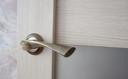 Stylish door handle in the room. Interior design.