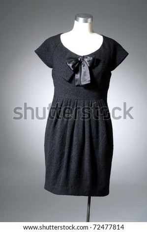 Stylish dress on mannequin on light background