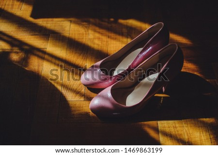 Stylish elegant lacquered classic pink shoes are isolated. Wedding accessory. Close up. Side view. #1469863199