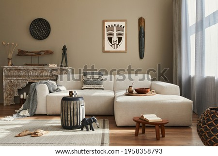 Stylish ethnic living room interior with design modular sofa, wooden stool, moroccan shelf, carpet decor, a lof of decoration and elegant personal accessories. in modern decor. Template.