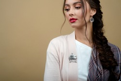 Stylish fashion girl advertises authentic accessories: silver brooch and earrings