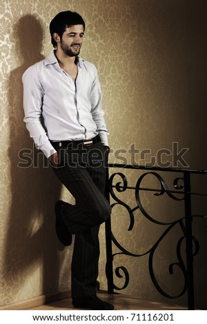 Stylish fashionable attractive young man, old type, full length photo