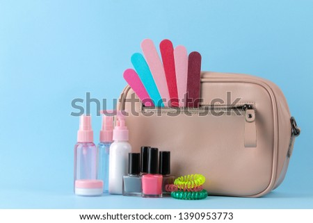 Stylish fashionable pink bag and women's cosmetics and accessories on a bright trendy naked background. female accessory concept.