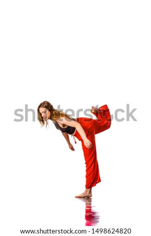 Stylish female hip hop dancer in dancing pose posing in studio. Exercise, gym, sport